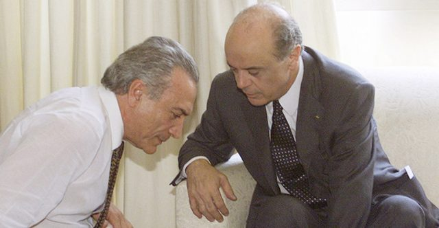 Brazilian Social Democratic Party (PSDB) presidential candidate Jose Serra (R) chats with Brazilian Democratic Movement Party (PMDB) President Michel Temer, in Brasilia, October 9, 2002. Serra, who finished second in the voting, will face off with Workers Party candidate Luiz Inacio Lula da Silva, in the runoff election on October 27. Serra's runningmate on the ruling coalition ticket is Lower House of Congress Deputy Rita Camata of the PMDB. REUTERS/Jamil Bittar  JB